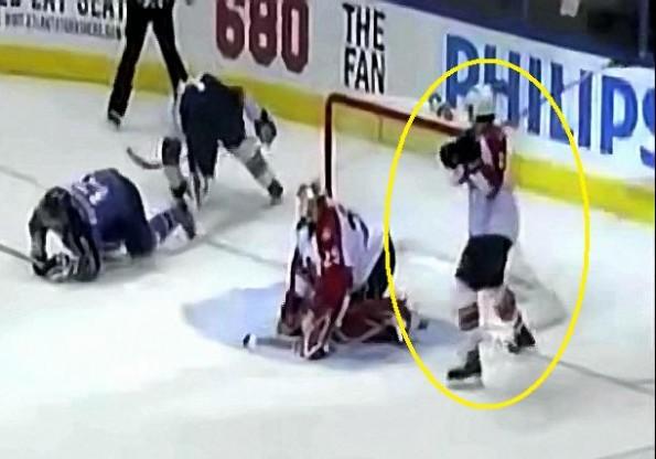 Keith Ballard Slahes His Goalie over the head