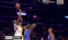 Kobe Bryant Hits A Shot From Behind The Backboard