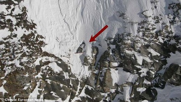 Snowboarder Clings to Edge of Cliff For His Life