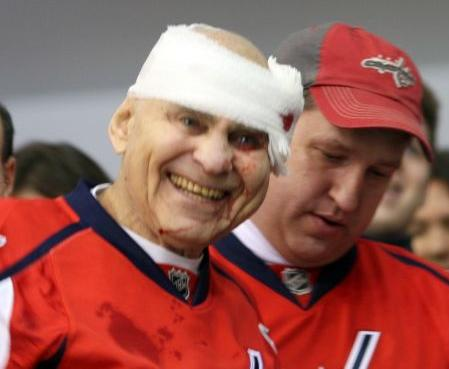 Old Man Gets Struck with Hockey Puck