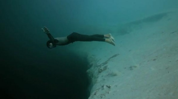 Free Diver Free Falls into Blue Hole