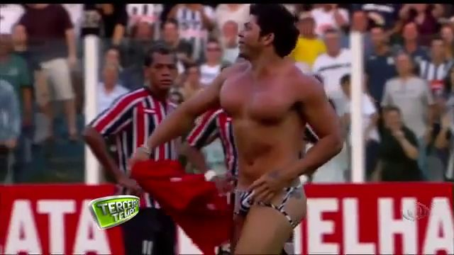 Male streaker with fake boobs invades soccer pitch