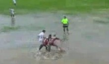 Brazilian Soccer Match Goes On Despite Flooded Pitch (Video)