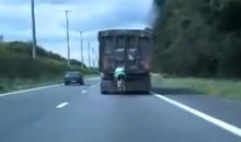 Cyclist Going 60 MPH Behind A Truck (Video)
