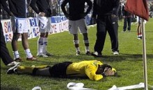 Soccer Linesman Hit In Head With Cash Register Paper Roll (Video)