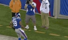 Michael Boley Celebrates TD By Throwing Ball At Intern's Face (GIF)