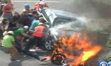 Utah Bystanders Lift Burning Car To Save Motorcyclist (Video)
