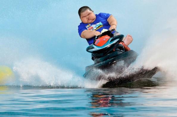 kid on a jet ski