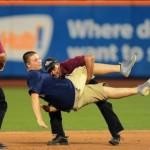 Baseball fan tackled