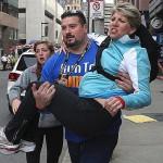 Joe Andruzzi carrying a Boston Marathon bombing victim to safety
