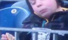 Kid Enjoys A Beer During A Soccer Match (Video)
