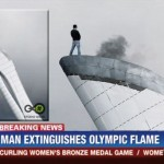 man extinguishes olympic flame