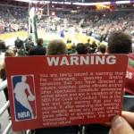 nba fan warning sign at game