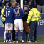 everton fan handcuff to goal post