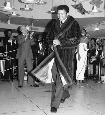 #13 muhammad ali in a fur coat