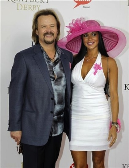 Country singer Travis Tritt arrives with a guest for the 138th Kentucky Derby