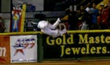 Two Minor League Outfielders Go Over The Wall To Make The Catch (Video)