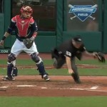 Home plate umpire trips over catcher