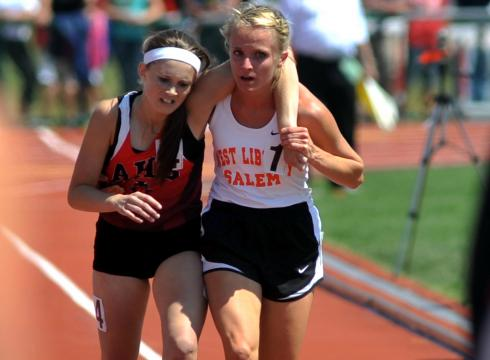 meghan vogel helps arden mcmath cross finish line