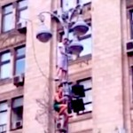 fans climb light pole at euro 2012