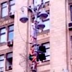 fans climb light pole at euro 2012