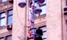 Bored Ukrainian Soccer Fans Climb Light Pole At Euro 2012 (Video)