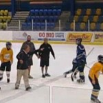minor hockey coach trips player in handshake line