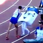 Mekhissi-Benabbad pushing mascot