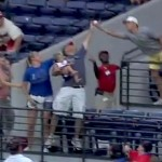 dad makes one-handed catch while holding baby