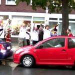german soccer fans cheer woman parallel parking