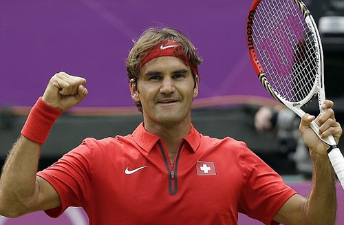 Roger Federer fist pumps