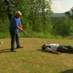 john daly hits golf ball out of david feherty's mouth