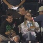 padres fan with a cast on hand makes nice catch