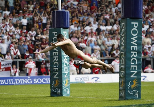 A Streaker dives over the tryline