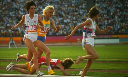 America's Mary Decker plunges to the infield grass after a collision with Zola Budd