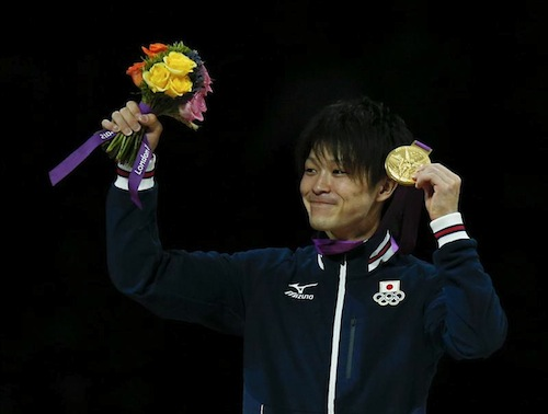 Kohei Uchimura of Japan shows off his gold medal during a ceremony after the men's individual all-around gymnastics final in the North Greenwich Arena during the London 2012 Olympic Games