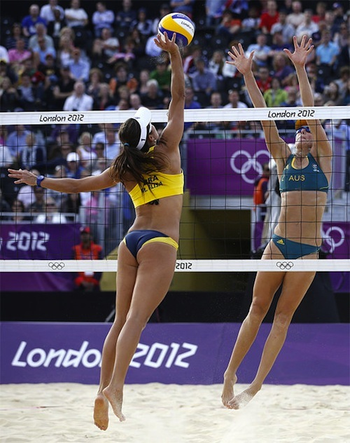 #25 2012 summer olympics beach volleyball Brazil's Maria Antonelli, left, spikes against Australia's Louise Bawden