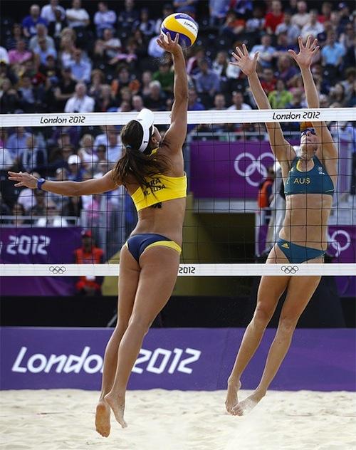 #25 2012 summer olympics beach volleyball Brazil's Maria Antonelli, left, spikes against Australia's Louise Bawden