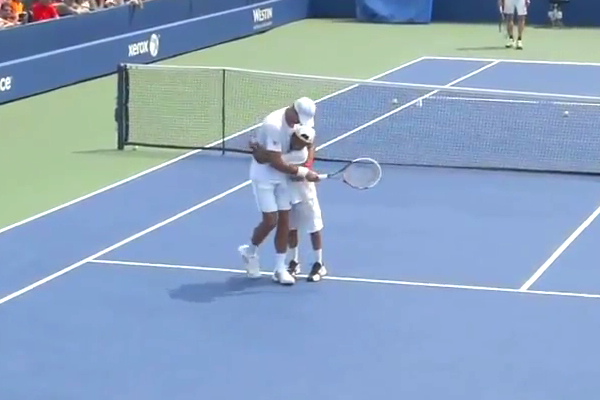 djokovic hugs fan during us open practice