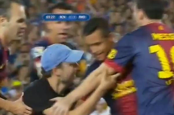 field invader celebrates with messi barcelona