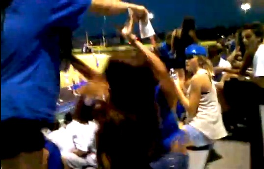 girls fight in stands at high school football game