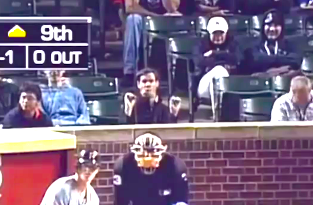 idiot making blowjob gesture behind home plate at wrigley field