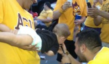 Parenting Skillz: Photo Surfaces Of Genius Holding Baby Up For Keg Stand At Arizona State Tailgate Party