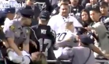 Female Raiders Fan Tries To Beat A Police Officer With His Own Handcuffs (Video)