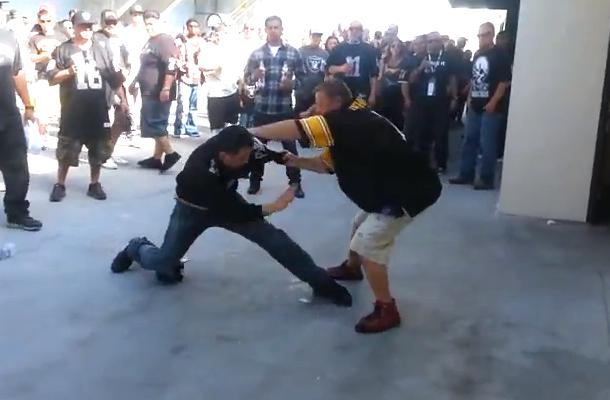 drunk raiders fan tries to fight steelers fan outside restroom