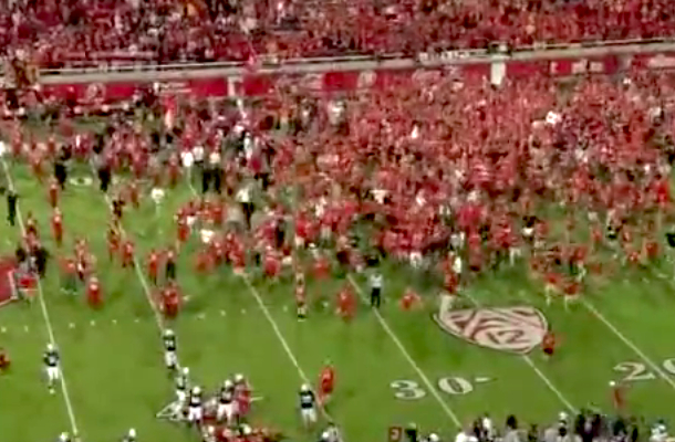 fans rush field after end of holy war utah byu