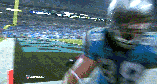 football player runs into camera