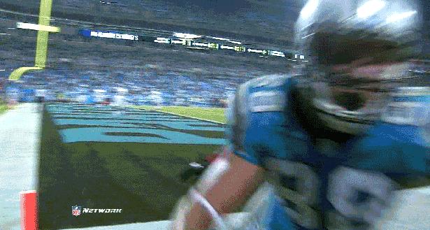 football player runs into camera
