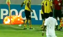 Soccer Player Almost Loses A Hand After Picking Up A Live Smoke Grenade Off The Field (Video)