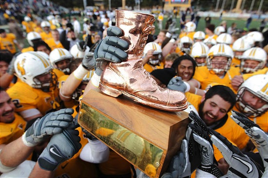 10 Bronze Boot Trophy - Border War (Wyoming Cowboys vs. Colorado State Rams) weird college football trophies